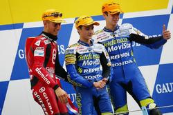 Podio: ganador de la carrera Dani Pedrosa, segundo lugar Manuel Poggiali, tercer puesto Joan Olive
