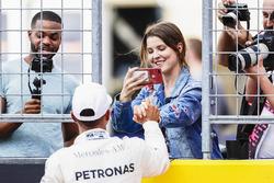 Lewis Hamilton, Mercedes AMG F1, celebrates, a friend after securing pole