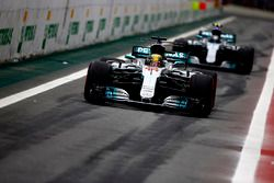 Lewis Hamilton, Mercedes AMG F1 W08, Valtteri Bottas, Mercedes AMG F1 W08, out of the pits at the start of Qualifying