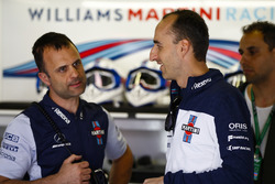 Robert Kubica, Williams Martini Racing, talks to colleagues