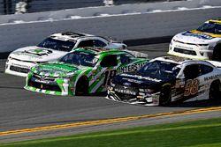 Daniel Suarez, Joe Gibbs Racing, Interstate Batteries Toyota Camry and Aric Almirola, Stewart-Haas R