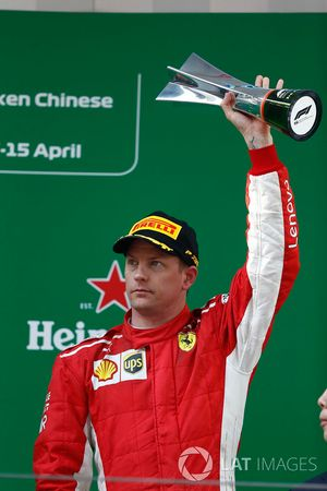 Kimi Raikkonen, Ferrari, 3rd position, on the podium with his trophy