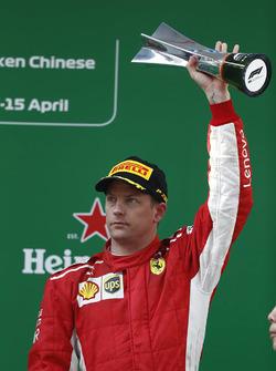 Kimi Raikkonen, Ferrari, 3rd position, on the podium with his trophy