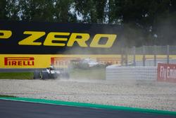 Romain Grosjean, Haas F1 Team VF-18, runs through a gravel trap after a misundrstanding with Sergey Sirotkin, Williams FW41