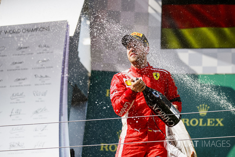 Sebastian Vettel, Ferrari celebrates by spraying champagne on the podium
