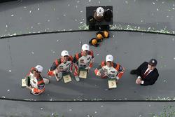 #54 CORE autosport ORECA LMP2, P: Jon Bennett, Colin Braun, Romain Dumas, Loic Duval celebrate in victory lane with Rolex watches