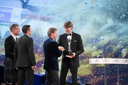 Marcus Gronholm presents the Rally Car of the Year Award for the Ford Fiesta RS WRC to Malcolm Wilso