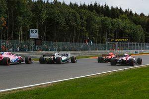 Sergio Perez, Racing Point Force India VJM11, Lewis Hamilton, Mercedes AMG F1 W09, Sebastian Vettel, Ferrari SF71H and Esteban Ocon, Racing Point Force India VJM11 battle on lap one