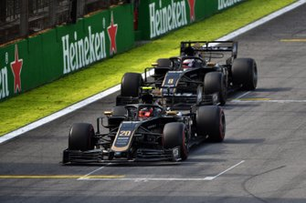 Kevin Magnussen, Haas F1 Team VF-19, leads Romain Grosjean, Haas F1 Team VF-19
