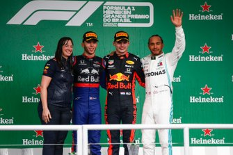 Podium: race winner Max Verstappen, Red Bull Racing, second place Pierre Gasly, Toro Rosso, third place Lewis Hamilton, Mercedes AMG F1, Hannah Schmitz, Red Bull Racing strategy engineer at Brazilian GP
