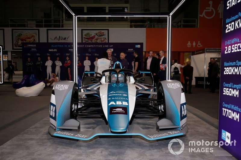 The Formula E car on the stand