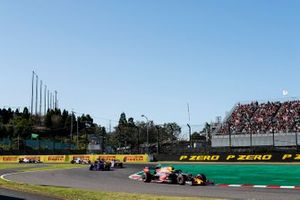 Alex Albon, Red Bull RB15, leads Pierre Gasly, Toro Rosso STR14, and Lance Stroll, Racing Point RP19