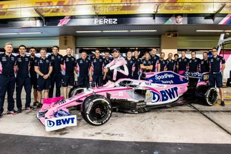 Sergio Perez, Racing Point, poses for a group photo with the 2019 team