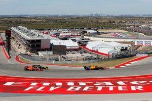 Lando Norris, McLaren MCL34, leads Daniel Ricciardo, Renault R.S.19 and Sebastian Vettel, Ferrari SF90