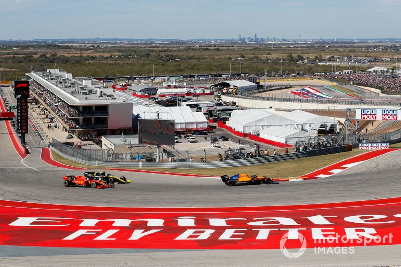 Lando Norris, McLaren MCL34, Daniel Ricciardo, Renault R.S.19 y Sebastian Vettel, Ferrari SF90
