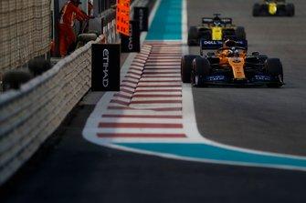 Carlos Sainz Jr., McLaren MCL34, leads Daniel Ricciardo, Renault F1 Team R.S.19, and Nico Hulkenberg, Renault F1 Team R.S. 19