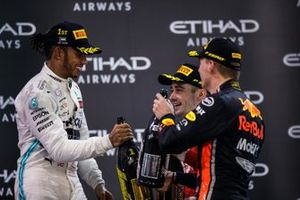 Lewis Hamilton, Mercedes AMG F1, 1st position, Charles Leclerc, Ferrari, 3rd position, and Max Verstappen, Red Bull Racing, 2nd position, celebrate with Champagne on the podium