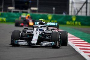 Valtteri Bottas, Mercedes AMG W10, leads Alex Albon, Red Bull RB15