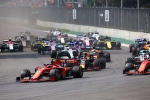 Charles Leclerc, Ferrari SF90 leads Sebastian Vettel, Ferrari SF90 and mMax Verstappen, Red Bull Racing RB15 at the start of the race