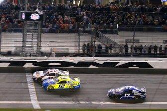 Denny Hamlin, Joe Gibbs Racing, Toyota Camry FedEx Express drives under the checkered flag to win