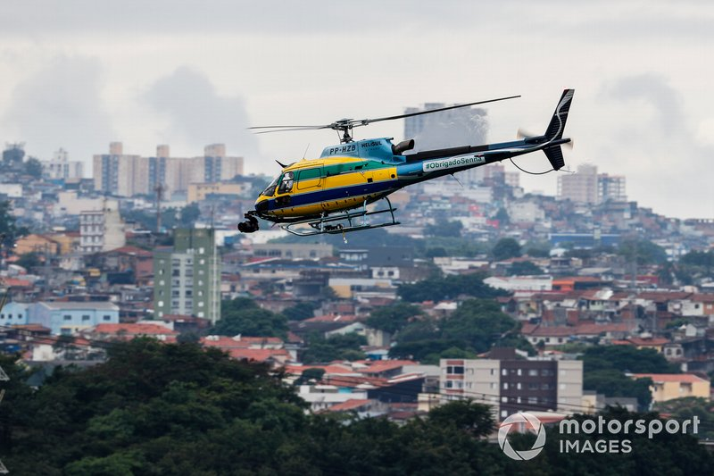An Helibrás AS-350B3 Esquilo (license built Eurocopter AS-350 Squirrel) camera helicopter in the same colours as the helmet of Ayrton Senna