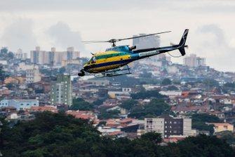 Вертолет AS-350B3 Esquilo в цветах шлема Айртона Сенны