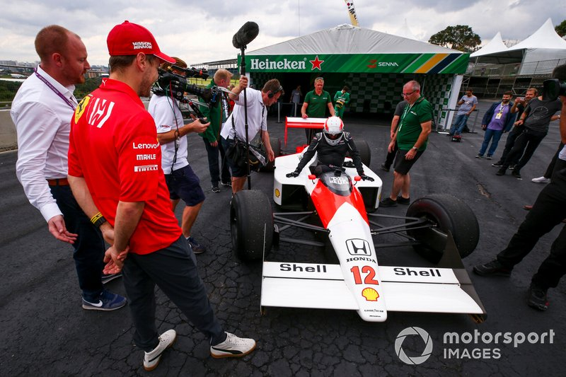 Sebastian Vettel, Ferrari looking at the McLaren MP4/4 with Martin Brundle, Sky TV