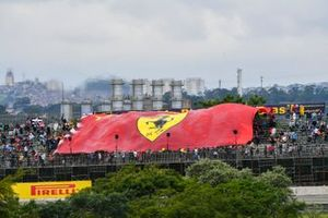 The crowd unveils a huge Ferrari flag