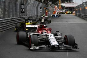 Kimi Raikkonen, Alfa Romeo Racing C38, leads Daniel Ricciardo, Renault R.S.19, and Kevin Magnussen, Haas F1 Team VF-19