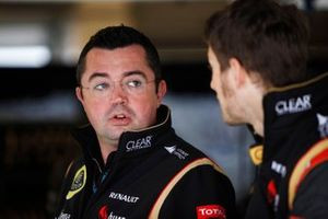 Eric Boullier, Team Principal, Lotus F1, talks with Romain Grosjean, Lotus F1