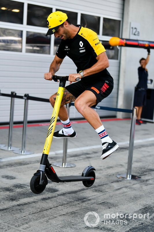 Daniel Ricciardo, Renault F1 Team plays on a scooter in the pit lane