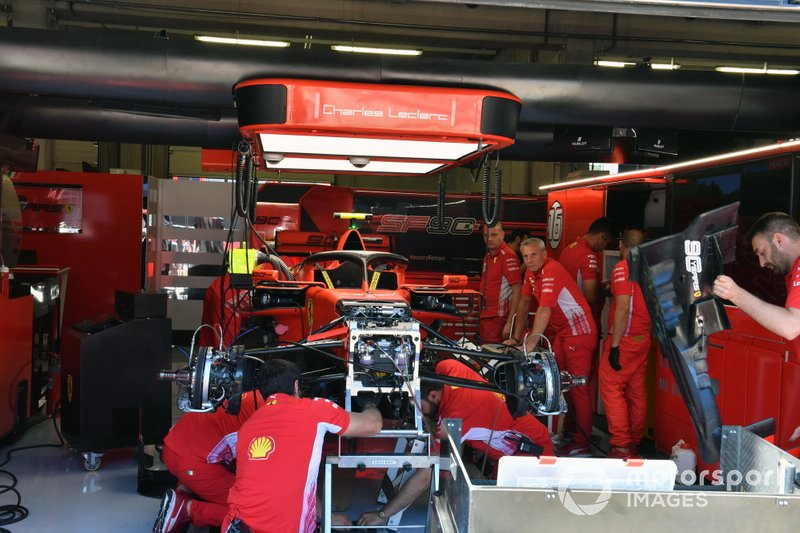 The Ferrari mechanics build the car for Charles Leclerc, Ferrari SF90, in the garage