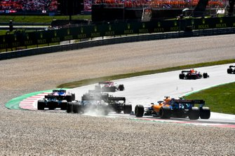 Daniel Ricciardo, Renault F1 Team R.S.19, leads Nico Hulkenberg, Renault F1 Team R.S. 19, Romain Grosjean, Haas F1 Team VF-19, Robert Kubica, Williams FW42, and Carlos Sainz Jr., McLaren MCL34, at the start