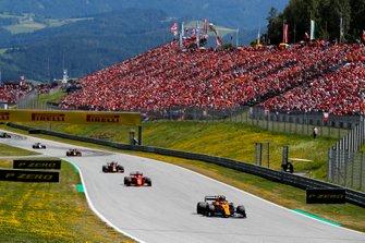 Lando Norris, McLaren MCL34, leads Sebastian Vettel, Ferrari SF90, Max Verstappen, Red Bull Racing RB15, and Pierre Gasly, Red Bull Racing RB15