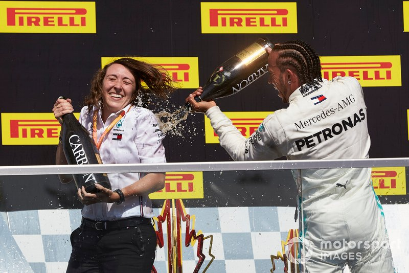 Lewis Hamilton, Mercedes AMG F1, 1st position, sprays Champagne on his team mate on the podium