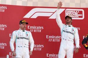 Valtteri Bottas, Mercedes AMG F1, 2nd position, and Lewis Hamilton, Mercedes AMG F1, 1st position, celebrate on the podium