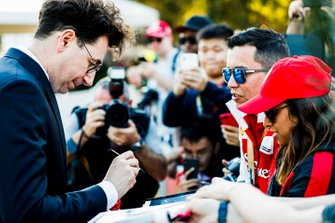 Mattia Binotto, Team Principal Ferrari signs an autograph for a fan