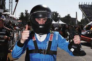 Enzo Bonito celebrates after winning a race