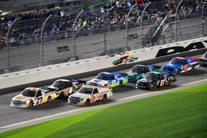 Myatt Snider, ThorSport Racing, Ford F-150, Brennan Poole, On Point Motorsports, Toyota Tundra, and Todd Gilliland, Kyle Busch Motorsports, Toyota Tundra JBL lead a pack of trucks