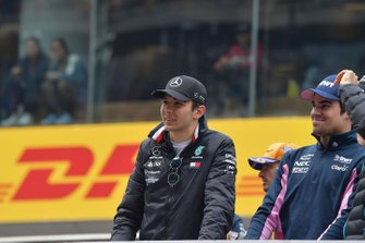 Esteban Ocon, Mercedes AMG F1, and Lance Stroll, Racing Point, in the drivers parade