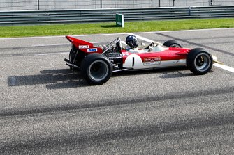 Damon Hill drives the Lotus 49 raced by his father Graham Hill in 1968