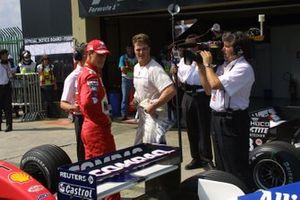 Michael Schumacher, Ferrari talks with Ralf Schumacher, BMW Williams