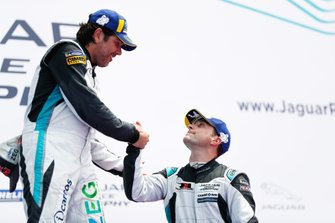 Cacá Bueno, Jaguar Brazil Racing, shakes hands with Bryan Sellers, Rahal Letterman Lanigan Racing, on the podium