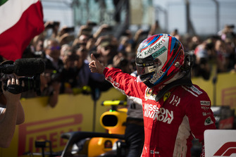 Kimi Raikkonen, Ferrari, 1st position, celebrates in Parc Ferme