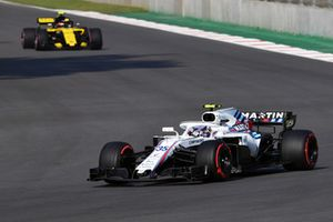 Sergey Sirotkin, Williams FW41 and Carlos Sainz Jr., Renault Sport F1 Team R.S. 18