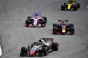 Kevin Magnussen, Haas F1 Team VF-18 leads Daniel Ricciardo, Red Bull Racing RB14 and Sergio Perez, Racing Point Force India VJM11