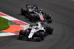 Sergey Sirotkin, Williams FW41 and Romain Grosjean, Haas F1 Team VF-18
