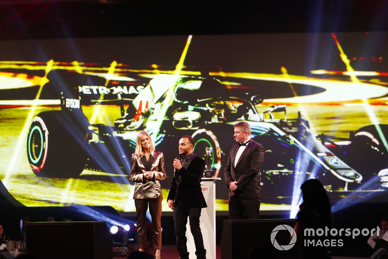 Nic Hamilton, brother of F1 World Champion Lewis Hamilton on stage to accept the British Competition Driver and International Racing Driver awards