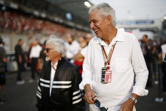 Bernie Ecclestone, presidente emérito de Fórmula 1., con Marco Tronchetti Provera, CEO de Pirelli