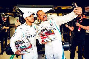 El piloto de Mercedes AMG F1 Lewis Hamilton y el actor Will Smith